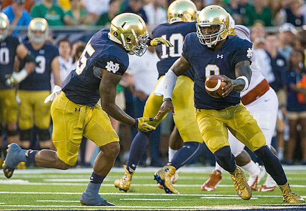 Notre Dame Fighting Irish football quarterback Malik Zaire (No. 8) and Tarean Folston (No. 25)