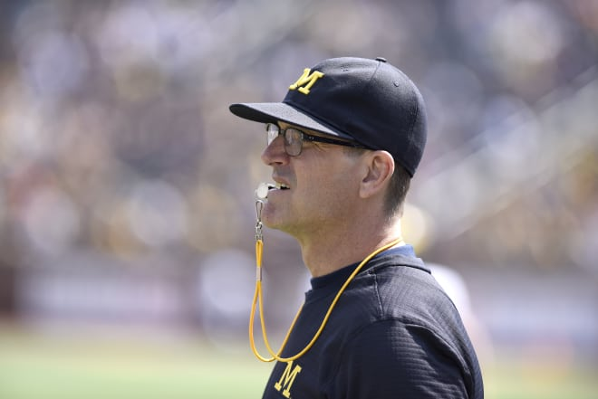Jim Harbaugh and Michigan are 39-point favorites Saturday.
