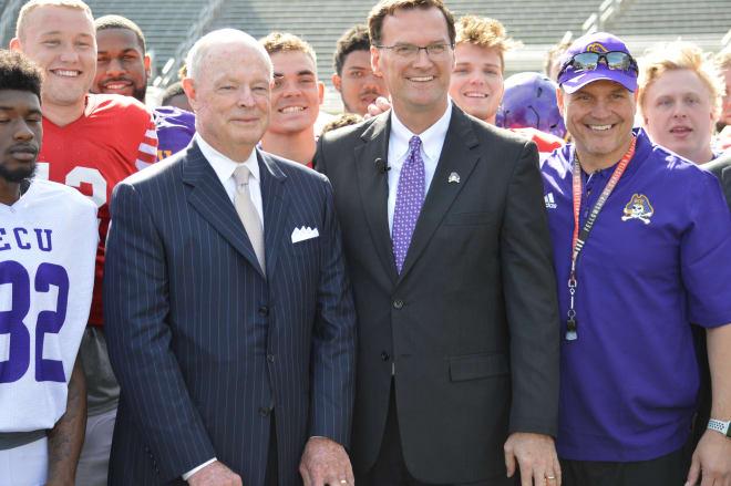 Bob Aston of TowneBank along with ECU athletic director Jon Gilbert and ECU head coach Mike Houston.