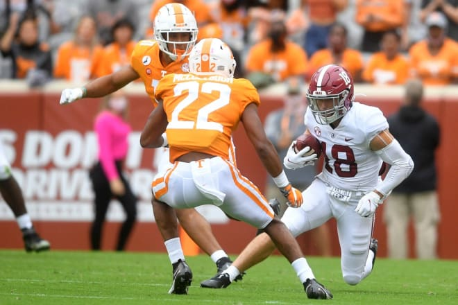 Alabama wide receiver Slade Bolden (18) runs the ball as Tennessee defensive back Jaylen McCollough (22) and Tennessee linebacker Henry To'o To'o (11) defend during a game between Alabama and Tennessee at Neyland Stadium in Knoxville, Tenn. on Saturday.