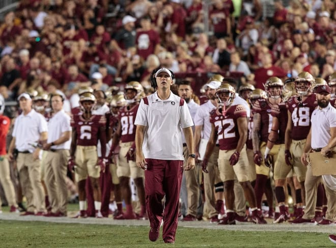 FSU football coach Mike Norvell looks for a replay on the big screen last Saturday night.