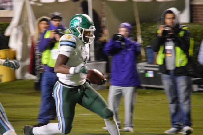Tulane quarterback Jonathan Banks scores the game winning touchdown in overtime to beat ECU.