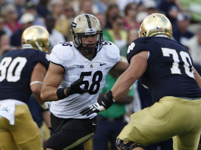 Robert Maci was a two-year starter at defensive end/linebacker. Some of his best memories were playing Notre Dame as he did in this 2012 image.