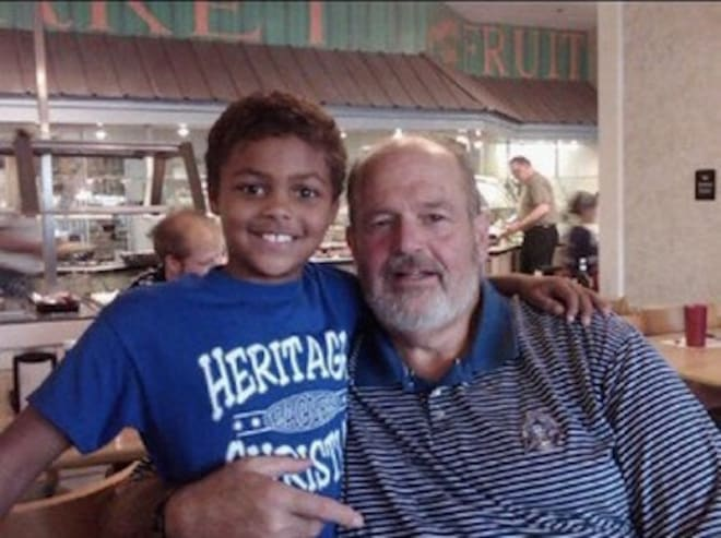 Indiana wide receiver signee David Baker as a child with his grandfather, John, who served as the primary father figure in Baker's life until his passing. (courtesy photo)
