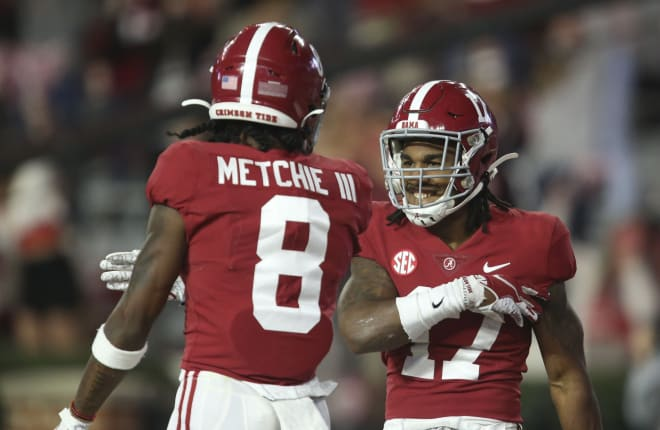 Alabama wide receiver John Metchie III (8) and Alabama wide receiver Jaylen Waddle (17) celebrate Waddle's 90 yard touchdown during the second half of Alabama's 41-24 win over Georgia at Bryant-Denny Stadium.