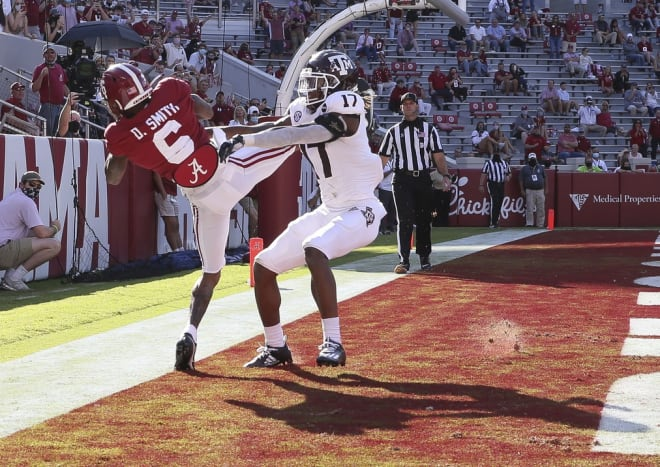 Alabama wide receiver DeVonta Smith (6) makes a catch and gets his foot down in bounds for a touchdown with Texas A&M defensive back Jaylon Jones (17) defending at Bryant-Denny Stadium. Photo | Imagn