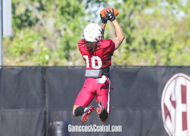 R.J. Roderick catches a pass during a drill in practice on Monday morning.