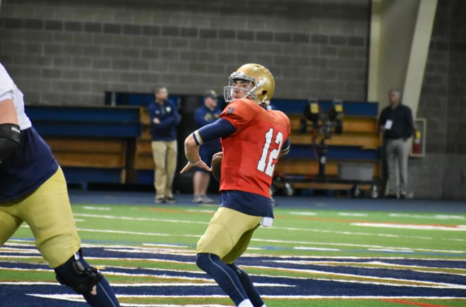 Ian Book and his Notre Dame teammates held a two-hour practice indoors on Tuesday.