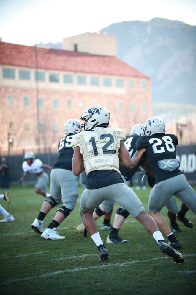 Freshman Brendon Lewis and junior transfer JT Shrout are currently engaged in a battle to end spring atop the depth chart at quarterback while Carter continues to learn the ropes of CU's offense.