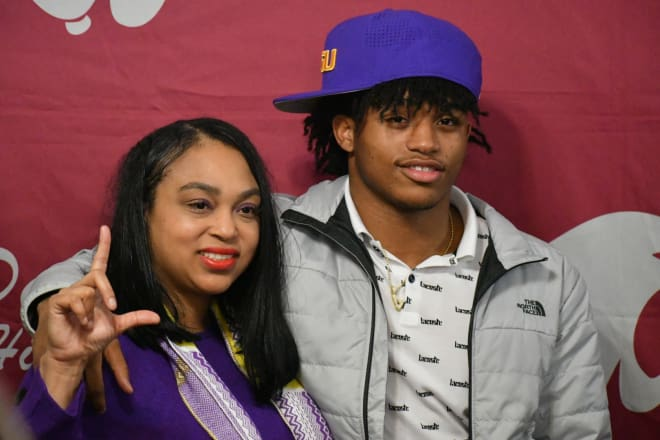 LSU signee John Emery Jr. (R) poses with his mother, Nikki Trudeaux, on Dec. 19, 2018 at Destrehan High School.