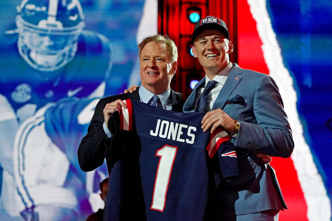 Mac Jones (Alabama) with NFL commissioner Roger Goodell after being selected by the New England Patriots as the number 15 overall pick in the first round of the 2021 NFL Draft at First Energy Stadium. Photo | USA Today