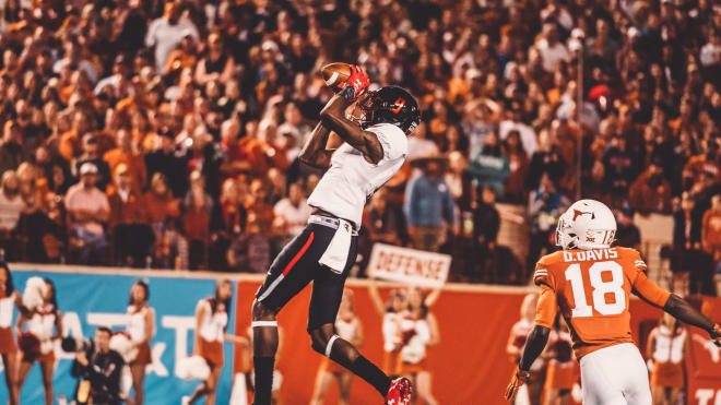 TJ Vasher goes up for a catch against the Texas Longhorns. (Photo by Texas Tech Athletics)