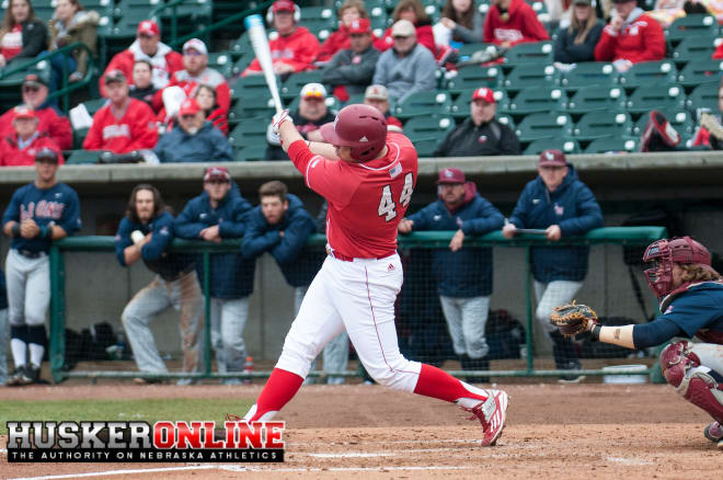 Nebraska hit two home runs and used a big eighth inning to defeat Indiana 7-3 in the Big Ten opener.