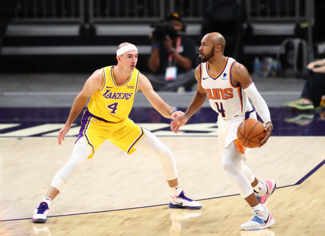 Jevon Carter spent the past two season with the NBA's Phoenix Suns.