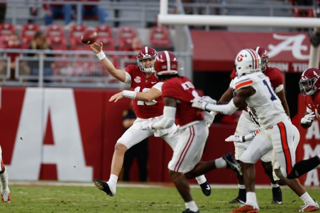 Alabama Crimson Tide quarterback Mac Jones delivers a pass during Saturday's Iron Bowl game against Auburn. Photo   Getty Images