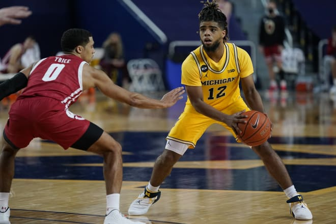 Michigan Wolverines basketball fifth-year senior guard Mike Smith notched 10 assists against Minnesota.