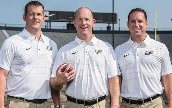 Born and raised in Louisville, Oscar Brohm's sons — Brian, Jeff and Greg (left to right) — each stood out on the sports scene in the city. Now, they're on Purdue's staff and will open the season against their alma mater.