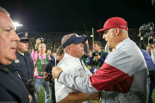 Notre Dame Fighting Irish football head coach Brian Kelly with USC head coach Clay Helton