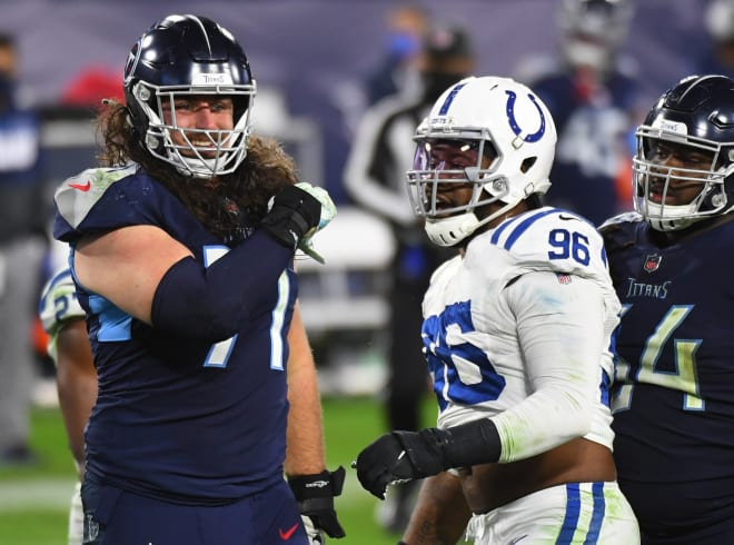 Tennessee Titans offensive tackle Dennis Kelly (71) and Indianapolis Colts defensive tackle Denico Autry (96) exchange words after a play during the second half at Nissan Stadium.