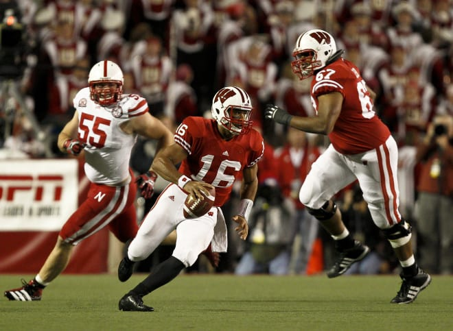 Josh Oglesby (67) looks to block for quarterback Russell Wilson during Wisconsin's 48-17 victory over Nebraska in 2011.