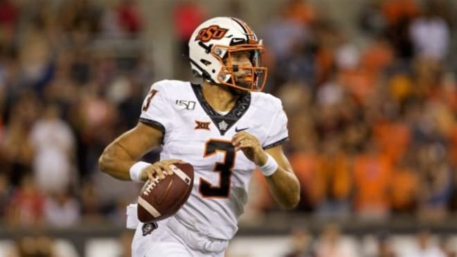 West Virginia Mountaineers football team does not know who will start at quarterback for Oklahoma State.