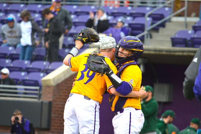 Seth Caddell congratulates Cam Colmore after the final pitch in ECU's 7-3 game three victory over William & Mary.