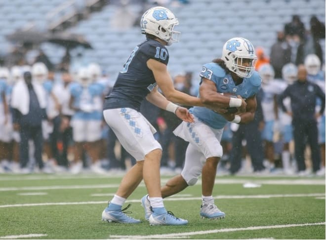UNC's running backs keep hearing about what the program lost from last fall, fueling their preparation for this season.
