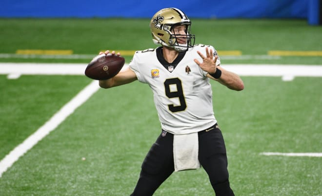 New Orleans Saints quarterback Drew Brees (9) drops back to pass against the Detroit Lions during the third quarter at Ford Field.