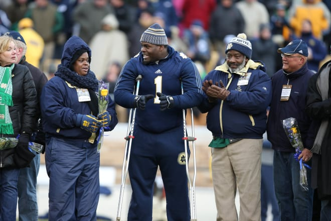 Notre Dame Fighting Irish football defensive tackle Louis Nix III with his parents on Senior Day in 2013