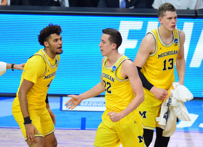 Michigan Wolverines basketball's Isaiah Livers with Duncan Robinson in 2018.