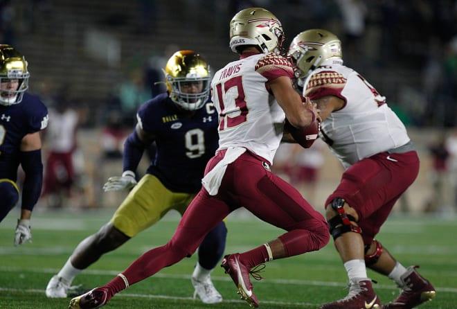 FSU quarterback Jordan Travis looks to avoid pressure during the Seminoles' game at Notre Dame last Saturday.
