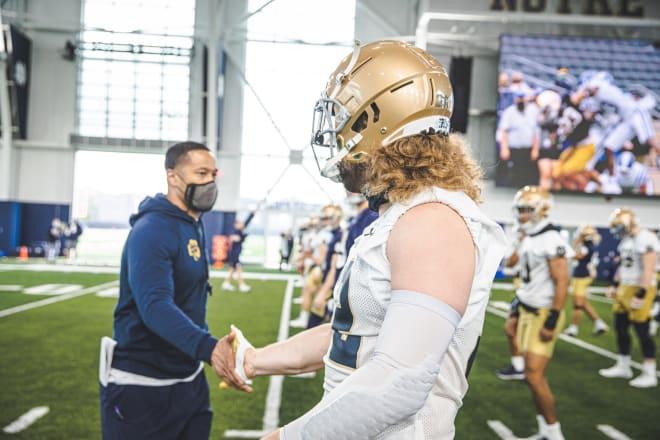 Notre Dame Fighting Irish football defensive coordinator Marcus Freeman with senior linebacker Bo Bauer