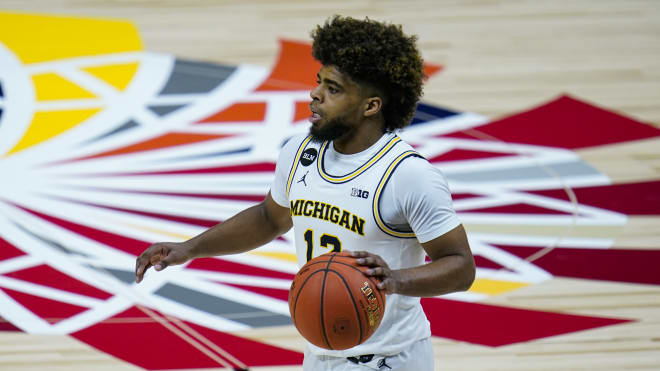 Michigan Wolverines basketball point guard Mike Smith averaged a Big Ten-leading 5.3 points per game last season.
