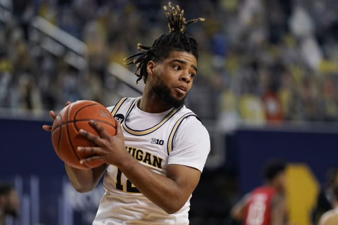 Michigan Wolverines basketball fifth-year senior guard Mike Smith hit his first three triples of the game.