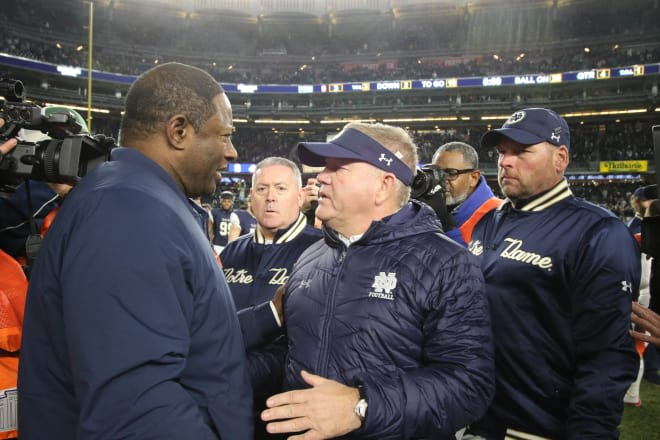 Notre Dame football head coach Brian Kelly with Syracuse head coach Dino Babers in 2018
