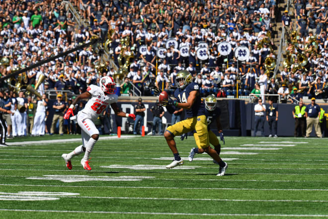 Freshman safety Kyle Hamilton returning his first career interception for a touchdown.