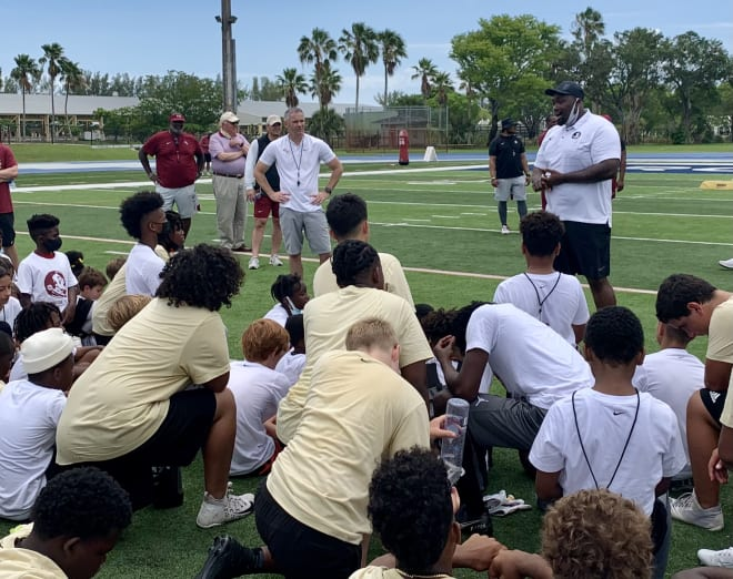 Former FSU and current NFL center Rodney Hudson speaks to the campers in South Miami on Saturday.