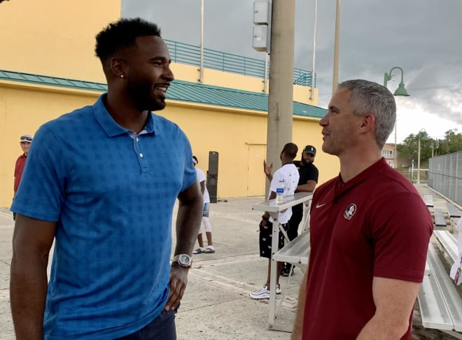 Florida State football coach Mike Norvell speaks with former FSU and NFL quarterback EJ Manuel before Friday's youth football clinic in Broward County.