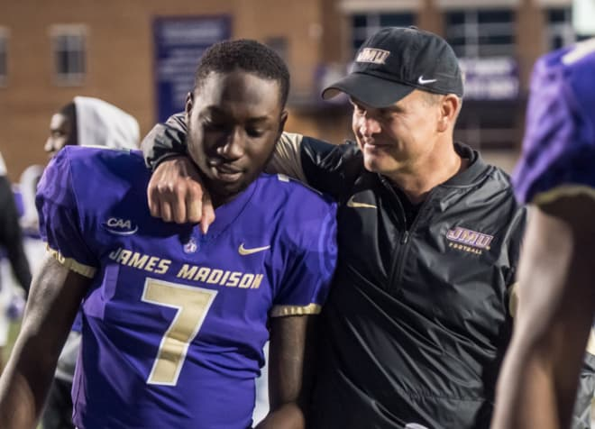 James Madison coach Mike Houston (right) celebrates a win last season with former wide receiver Terrence Alls, who transfered to the school in 2016 after starting his career at Duke.