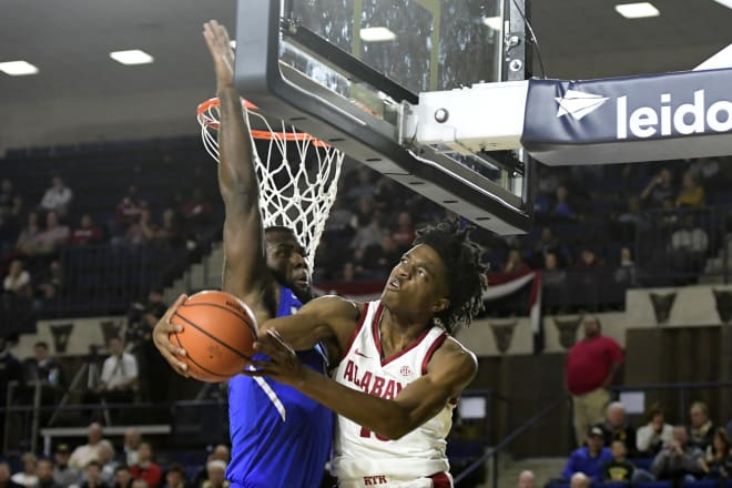 Alabama Crimson Tide guard Herb Jones (10) looks to shot as Memphis Tigers forward Raynere Thornton (4) defends during the second half, in game one of the Veterans Classic at Alumni Hall. Alabama Crimson Tide defeated Memphis Tigers 82-70. Photo | USA Today