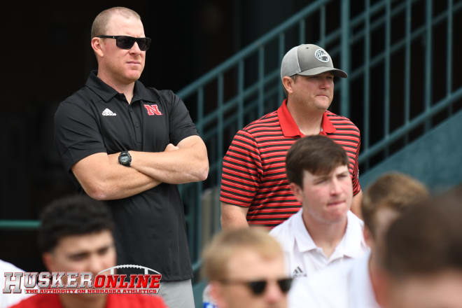 Assistant coach Lance Harvell (left) and head coach Will Bolt (right) watch the NCAA regional selection show.