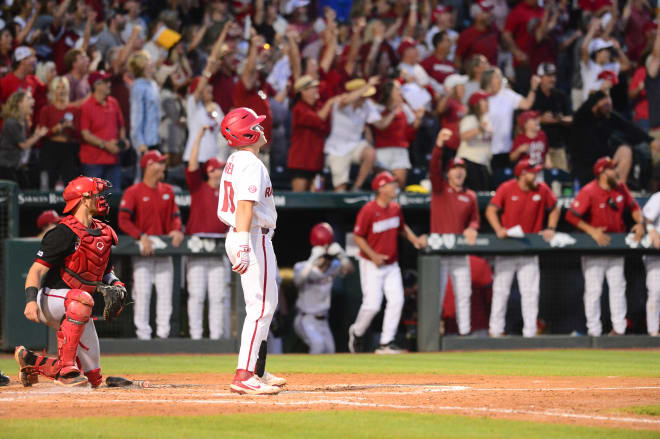 Charlie Welch admires his three-run home run that essentially iced Arkansas' win over Nebraska on Monday.