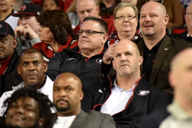 Sam Pittman sits behind Georgia senior associate director of S&C Ed Ellis.