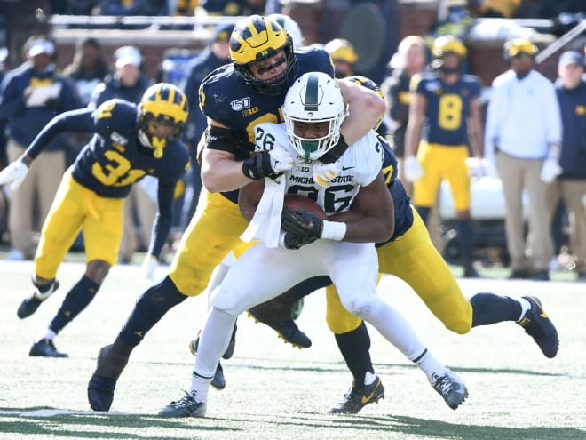Michigan Wolverines football redshirt junior defensive end Aidan Hutchinson played in only three games last season before being injured.