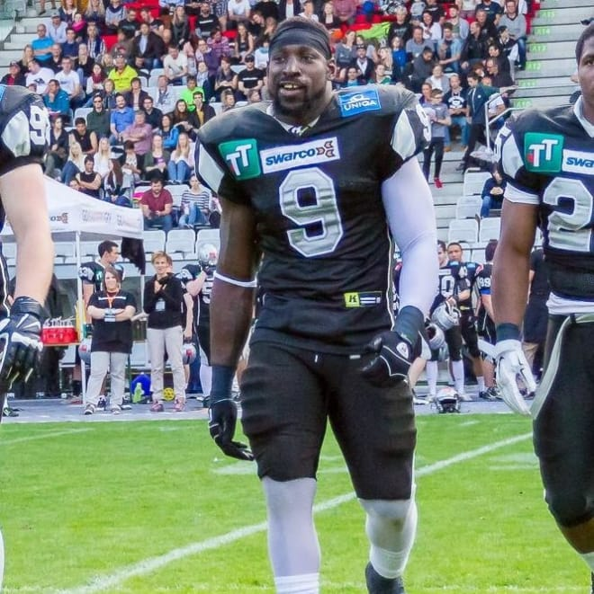 Wendell Brown playing football in China.