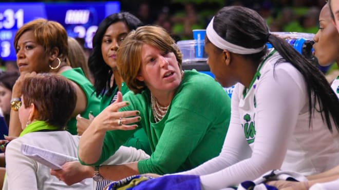 Former Notre Dame player and assistant coach Beth (Morgan) Cunningham gives instruction to Arike Ogunbowale during a game
