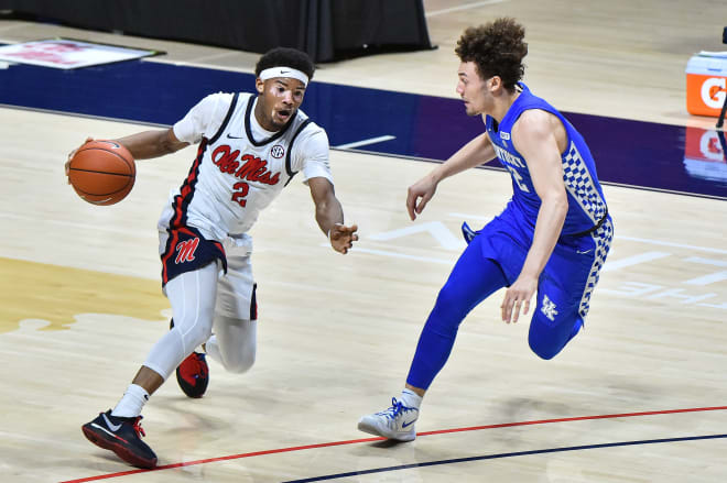 Ole Miss Rebels guard Devontae Shuler (2) handles the ball against Kentucky Wildcats guard Devin Askew (2) during the second half at The Pavilion at Ole Miss. Mandatory Credit: Justin Ford-USA TODAY Sports