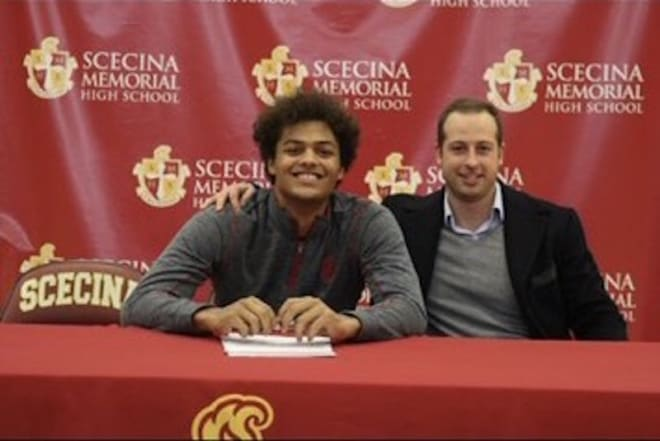 Indiana wide receiver signee David Baker with former Ball State wide receiver and current Scecina Memorial wide receivers coach Jared Scaringe during Baker's signing with Indiana on Dec. 18, 2019. (courtesy photo)