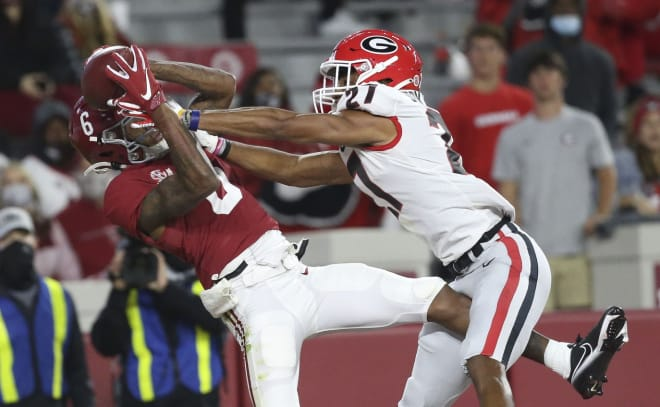 Alabama wide receiver DeVonta Smith (6) catches a touchdown pass over Georgia defensive back Eric Stokes (27) during the second half of Alabama's 41-24 win over Georgia at Bryant-Denny Stadium. Photo | Imagn