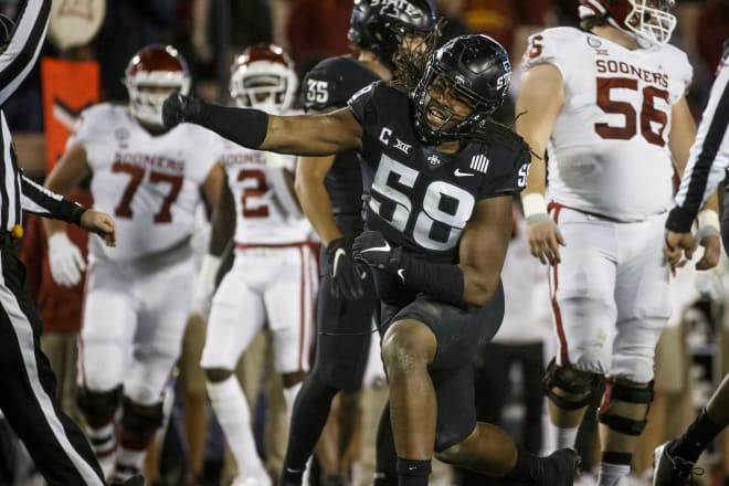 Defensive end Eyioma Uwazurike celebrates a tackle during a win against Oklahoma in Ames.